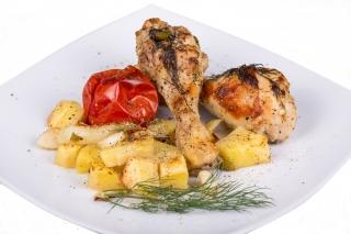 Jamoncitos de pollo al horno con patatas y cebolla